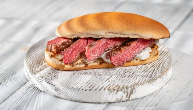 Sandwich with sliced beef steak