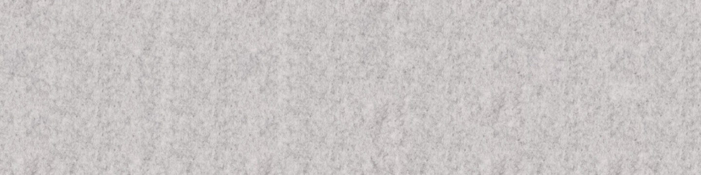 Fragment of grey thick felt material. Panoramic seamless texture