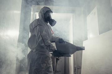 male in protective hazmat suit disinfect public isolated spaces, carrying barrels, pathogen respiratory quarantine coronavirus covid-19 concept