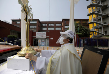 Angel Lauro Sanchez, parish priest of Catholic Church of the Lady of the Rosary, performs a procession in the streets with the image of the Sacrament Jesus to pray for soon dissipate the current situation coronavirus pandemic, in Mexico