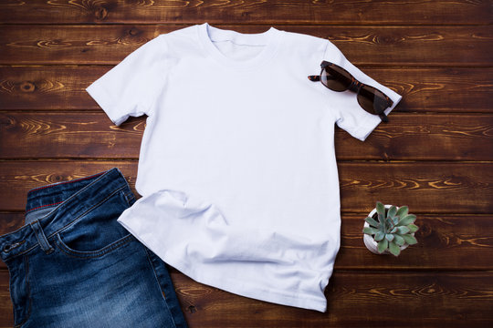 Unisex T-shirt mockup with jeans and succulent