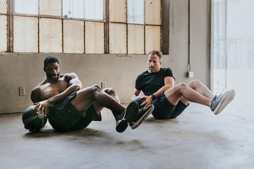 Fit men doing ab workout