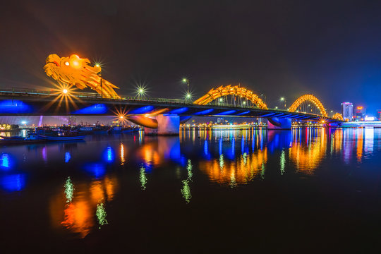 Dragon Bridge in the evening as it is illuminated with colourful LED lights, Han river in Da Nang, Vietnam.