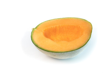 Cantaloupe melon cut in half with seeds scooped out. Also known as rockmelon, sweet melon or spanspek (Cucumis melo). Orange sweet flesh, netted rind. Isolated on white.