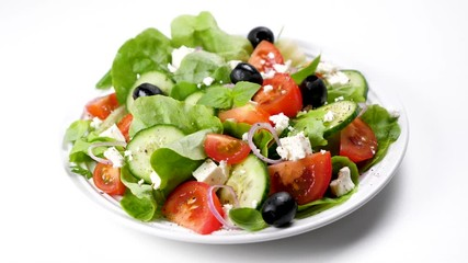 Wall Mural - greek salad with tomato, olive, cucumber, onion and feta cheese