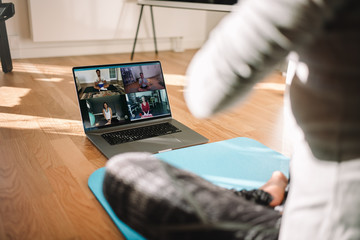 Woman conducting virtual fitness classes over video conference