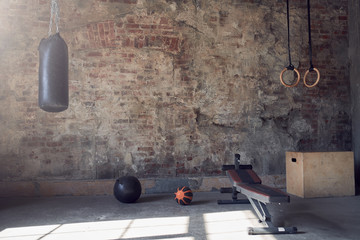 Gym with old brick wall with sports equipment