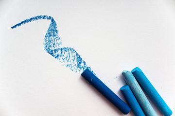 Blue oil pastels on white paper.