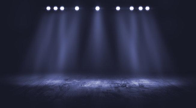 Dark stage with spotlight background.