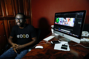 Nigerian filmmaker, Niyi Akinmolayan who created an animated video to educate kids on coronavirus, attends an interview with Reuters in his home, amid the spread of the coronavirus disease (COVID-19), in Lagos