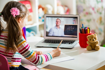 Fototapeta Middle-aged distance teacher having video conference call with pupil using webcam. Online education and e-learning concept. Home quarantine distance learning and working from home. obraz
