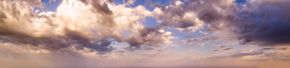 Wall Mural - Summer evening sky panorama with clouds background.