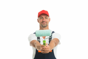 Color man. Man painter decorator isolated on white. Handy man hold paint roller. Work man wear working clothes. Renewal and redecorating. Renovation and repair. Decorating work