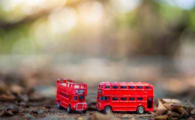 Printed roller blinds London red bus toys that represent two of the main symbols of the city of London, double-decker bus on blurred background. selective focus and grain nose.