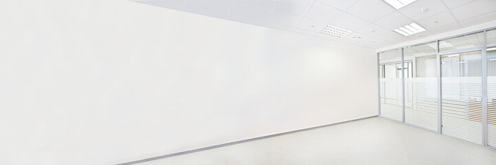 Empty office room with glass wall