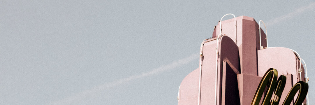 Pastel pink Art Deco building in Los Angeles website banner