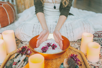 Hands in a salt bowl ceremony at a women's circle