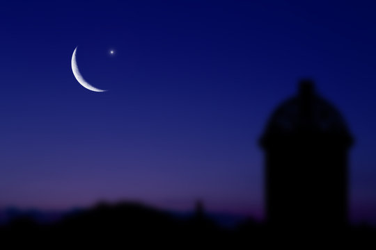 The Muslim feast of the holy month of Ramadan Kareem. Beautiful background with dark shadow lantern against the night sky with star and Crescent moon. Free space for your text