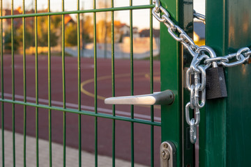 Football pitch closed with a padlock due to Covid-19. Poland, Europe