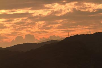 Fotorolgordijn Chocoladebruin Scenic View Of Silhouette Mountains Against Orange Sky