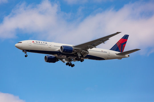 Chicago, USA - April 15, 2020: A Delta Airlines Boeing 777 aircraft landing at O'Hare International Airport.
