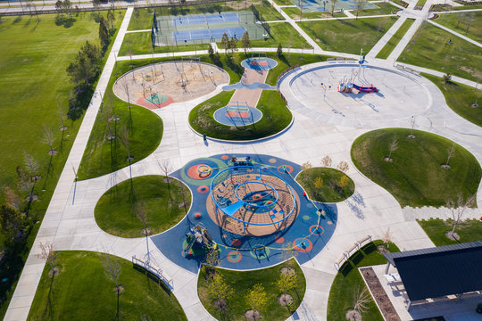 High aerial view of park with playground and splash pad closed for coronavirus