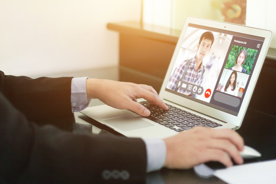 businessman talking colleagues about plan life in video conference. Multiethnic business team laptop online meeting in video call.smart working from home,