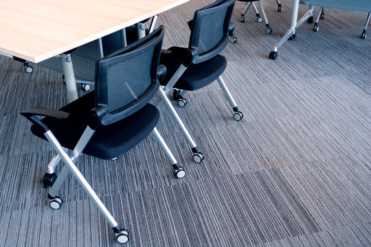High Angle View Of Office Chairs By Desk In Office