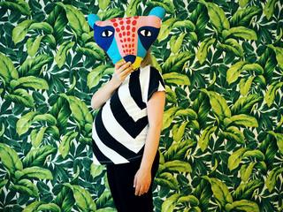 Woman Holding Animal Mask