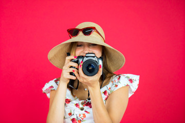 Gorgeous woman taking photo with digital camera