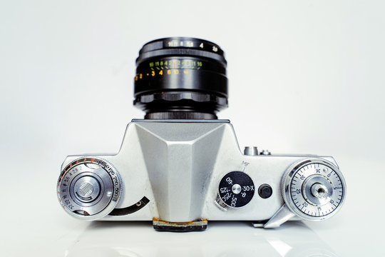 A soviet union camera Zenit E produced in 60s and 80s as an analogue to the German Leica. Very old film camera in shabby shape.
