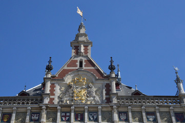 facade of the central station of Amsterdam with a golden crown and two lions