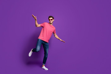 Full size photo of cheerful cool guy night club music lover dance disco floor enjoy hip hop rock concert free time wear style stylish outfit footwear isolated bright color background Wall mural