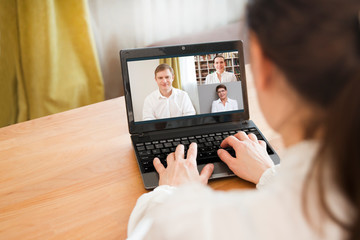 Fototapeta online conference. Businesswoman using laptop making video call to business partner. Home office. Group of people smart working from home. obraz