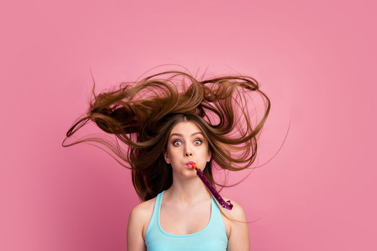 Portrait of her she nice-looking attractive lovely charming funny comic cheerful cheery straight-haired girl blowing whistle having fun ideal silky hair flying isolated on pink pastel color background