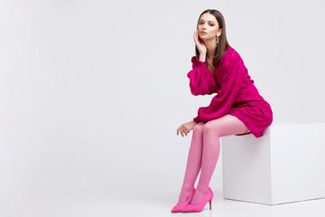 Fashion model in magenta dress.