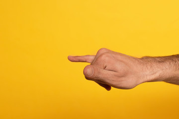 Cropped view of man showing letter from alphabet of Cyrillic sign language isolated on yellow