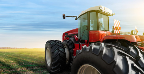 Wall Mural - Back view of tractor on a agricultural field