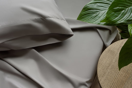 Bed linen in gray, silk fabric texture, bedclothes