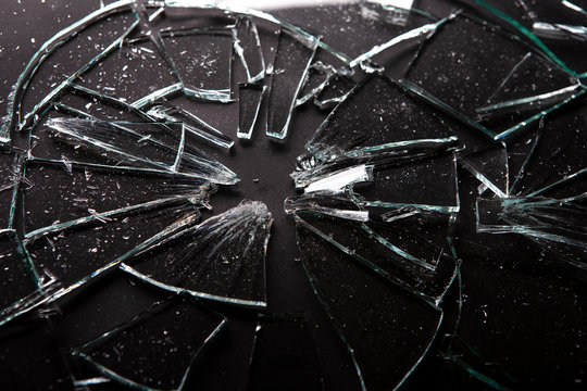 Broken glass with lots of  splinters on black background  for artistic backgrounds