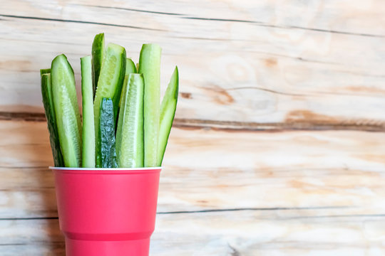 Chopped cucumber in a paper cup. Healthy vegan food. Vegetable snack
