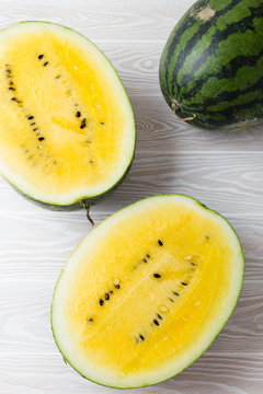 Yellow watermelon on white wooden background