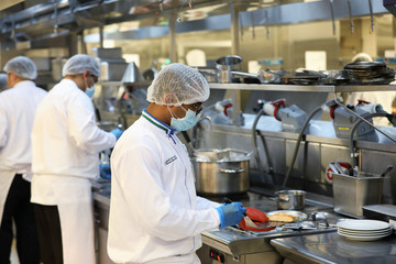 Hospital staff preapre meals for patients, amid the coronavirus disease (COVID-19) outbreak, at the Cleveland Clinic hospital in Abu Dhabi