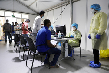 Members of medical staff wearing protective equipment, intake patients to be tested, amid the coronavirus disease (COVID-19) outbreak, at the Cleveland Clinic hospital in Abu Dhabi