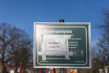 Germany,?Brandenburg, Playground closed message taped on playground information sign during COVID-19 epidemic Wall mural
