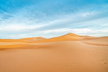 Peaceful landscape of Sahara Desert sand dunes, Morocco.