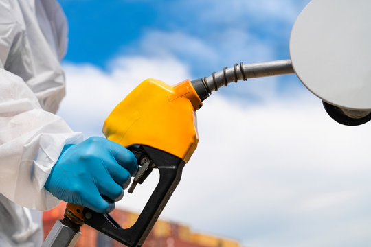 Refuelling the car at a gas station fuel pump. Drop of the prices in fuel industry affected by corona viruses