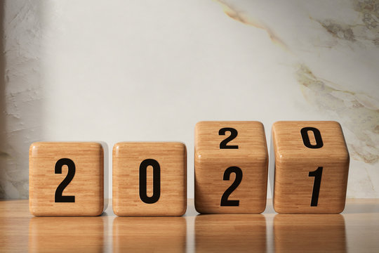 cubes turning from year 2020 to 2021 in front of marble background