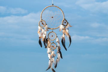 Low Angle View Of Dreamcatcher Hanging Against Sky