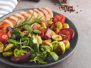 Fototapete - roasted sliced chicken fillet with vegetable brussels sprouts, tomatoes, sunflower sprouts on  plate healthy food